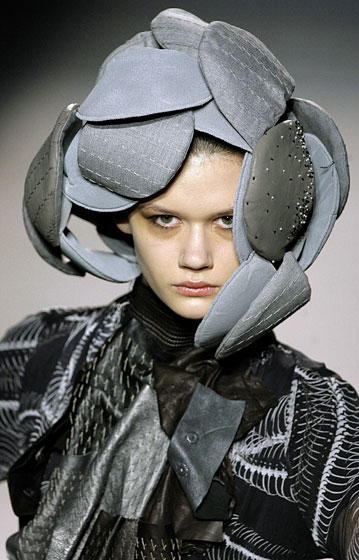 Aminaka Wilmont showed this during Barcelona Fashion Week. Wear it slightly askew, and your face and mouth are covered. And if you don't want to look <em>too</em> weird, you can just wear it as a hat.