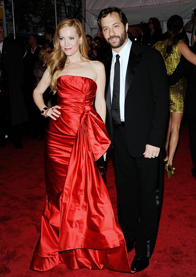 Judd Apatow and Leslie Mann, in an Oscar de la Renta gown, Christian Louboutin shoes, and H.Stern jewelry.