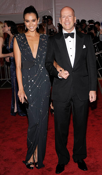 Bruce Willis and Emma Heming in a Donna Karan gown and Fred Leighton jewelry.