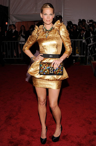 Molly Sims in a Dolce & Gabbana dress, and a necklace and bracelets by Tom Binns.