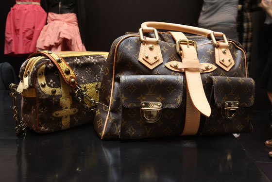 Special edition Louis Vuitton bag with chain strap, $1,250 (<em>left</em>); new Louis Vuitton bag with front pockets, $670 (<em>right</em>).