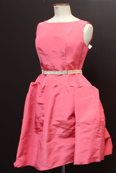 "Pink silk Oscar de la Renta dress, $970; pearl Valentino belt, $150. Garkinos calls this the ""ode to SJP"" dress because the actress once <a href=""http://images.google.com/imgres?imgurl=http://images.usatoday.com/life/_photos/2004/2004-01/02-satc-parker-misha-inside.jpg&imgrefurl=http://www.usatoday.com/life/television/news/2004-01-02-satc-main_x.htm&usg=__hZcvYeGiPvxMxLJvsACoX9r_MvE=&h=180&w=180&sz=7&hl=en&start=3&um=1&tbnid=DfeP4Npw00mKLM:&tbnh=101&tbnw=101&prev=/images%3Fq%3D%2522carrie%2Bbradshaw%2522%2B%2522petrovsky%2522%2Busa%2Btoday%26hl%3Den%26rlz%3D1T4ADBF_enUS300US301%26um%3D1"">wore it</a> in an episode of <em>Sex and the City</em>."