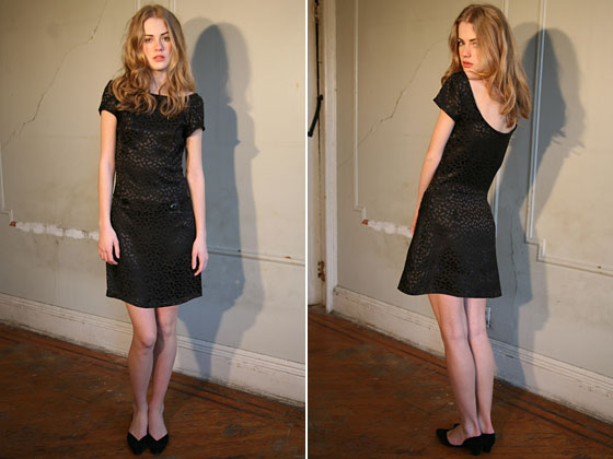 A black silk dress from the fall 2009 collection features a scoop back.