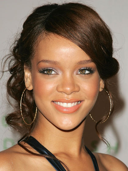 "Peachy lips, eyes, and cheeks may not have been a daring look, but it was cute and girlie, which is what her label preferred. They even wanted her to <a href=""http://www.imnotobsessed.com/2008/09/16/rihanna-says-cutting-her-hair-helped-her-take-back-control-of-her-life"">keep her long extensions</a> in."