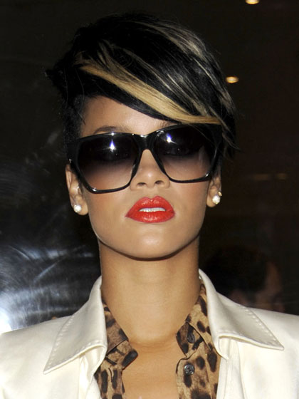 Even the coolest fashion editors and socialites gawked when RiRi made her entrance. Her bright-orange lips were cool, risky, and sexy.