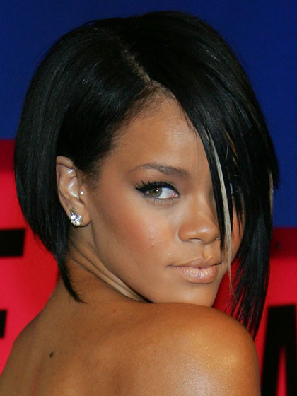 The asymmetrical haircut that catapulted Rihanna into the beauty stratosphere. Razor sharp, with a blonde streak thrown in for good measure. It pains us to point out that her heavily powdered face appears to be five shades lighter than the rest of her body.