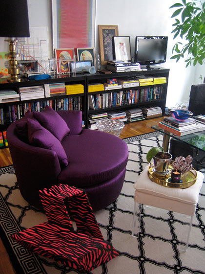 No surprise, I found his one-bedroom apartment in Chinatown totally inventive and cool. He's loaded up the living room with unabashed colors, like this deep-purple chair and the angular end table (his design).