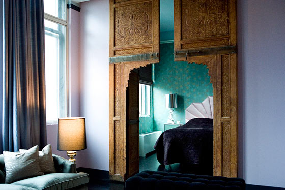 The doors to Stam's bedroom are Moroccan, which Rafael salvaged and then stripped. The bedroom wallpaper is vintage thirties copper leaf from Second Hand Rose.