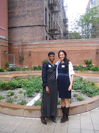 The Marcello Manor apartment complex, just completed by the New Destiny Housing Corporation in the Bronx, was designed as a serene haven for survivors of domestic violence. Here is designer Sara Bengur in the garden with Nadine, one of the residents.