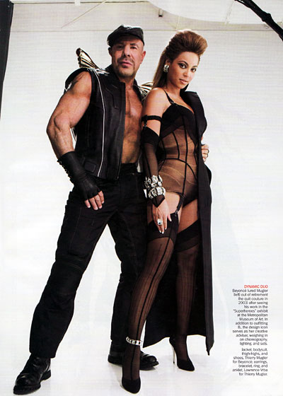 Thierry Mugler and Beyonce look amazing together. Like he's about to punch his fist skyward and airlift off on a glorious journey to a land where robots and motorcycle bustiers roam wild and free!