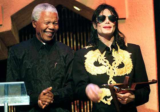 Jackson, in a gold-dragon jacket, with Nelson Mandela at the Kora All Africa music awards.
