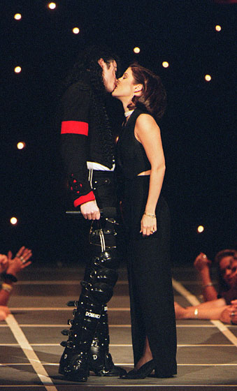 We may all remember the kiss, but the boots, pants, and armband are also pretty memorable.