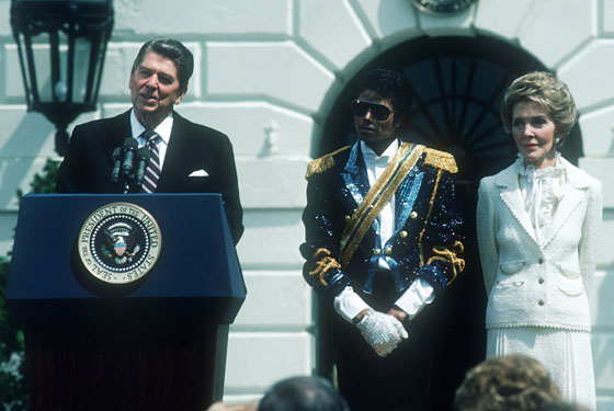 Michael visits President Reagan and Nancy Reagan at the White House in his best military attire.