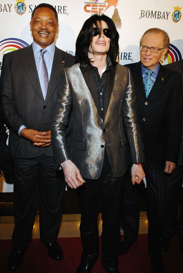 Even in a simple blazer and slacks, Jackson found a way to shine. Here, he's wearing a metallic jacket, celebrating the birthday of Reverend Jesse Jackson Sr., along with Larry King in Beverly Hills, California.