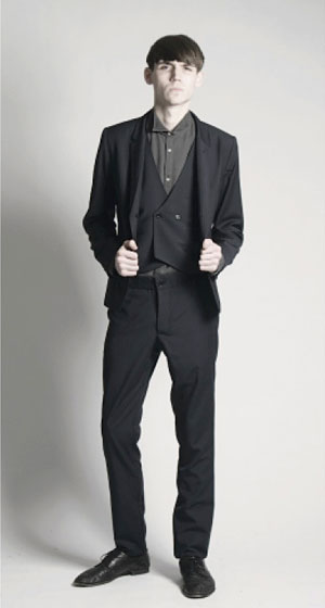 Romstoy suit coat, $416; isolde double-breasted vest, $188, with Mark Drop yoke slacks, $227.