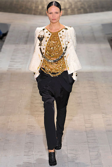 "It turns out we're totally into metallics right now. <a href=""http://nymag.com/fashion/fashionshows/2009/fall/main/europe/couturerunway/givenchy/"">Givenchy</a>'s gold draped shirt and swingy jacket are so stylish together -- if you close your eyes, you can see Rihanna in them -- that we'll forget that we don't totally understand the bling-string that's holding it together. Is it a tribute to orthodontia? Regardless, we probably wouldn't knock out our own teeth for the right to own this look, but we'd certainly think twice about knocking out someone else's. Prison is only temporary, but fashion -- and the ability to chew food without dentures -- is forever."