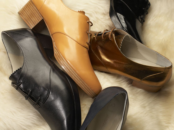 Nappa-leather Solid Jazz Shoe in black, miele and navy, $410; metallic-leather Jazz Shoe in gold and patent black, $450.