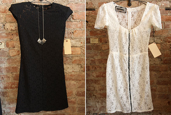 Black lace dress, $185 with hanging silver-spiked necklace, $115; white lace zip-up dress, $185.