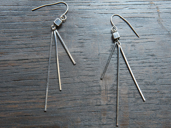 Silver three-spike earrings, $55.