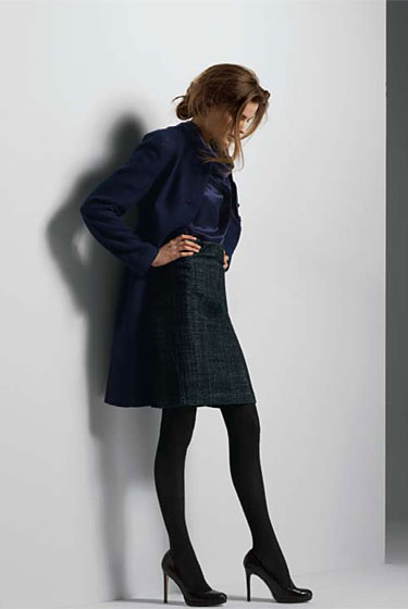 Bouclé Tweed Long Lady Coat $295. Sleeveless Ruffle-Collar Shell, $70. Tweed Pencil Skirt $120. Opaque Tight $16.