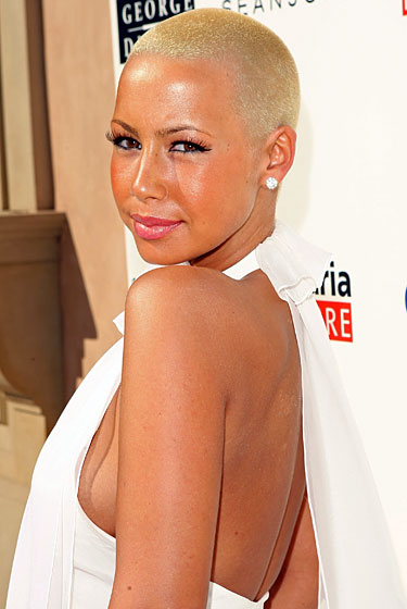 Of all the shaved heads in this slideshow, we think Amber pulls off the style better than anyone. Perhaps it's because we've only known her this way, rather than having had her shaved look emerge as a <em>shocking transformation</em> we can never really accept. Or perhaps she is the icon of fashion — of <em>culture</em> — who will finally prompt society to deem a full head of peach fuzz as beautiful as hair that whips through a breeze. And maybe the women who have shaved only part of their heads are simply trying, whether they realize it or not, to slowly become her. 