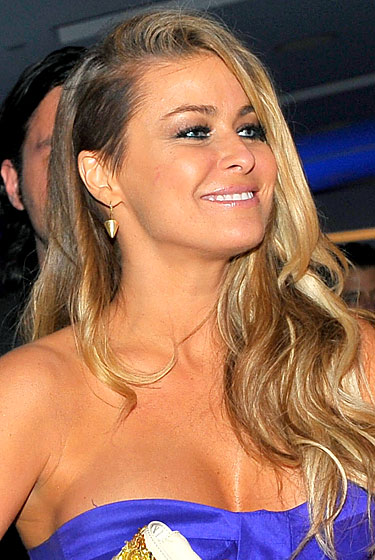 Carmen Electra followed Cassie in shearing off a portion of hair above her left ear (does Kabbalah say the right side is unlucky?). The do more closely resembles Alice Dellal's than Cassie's. Hopefully the former was her inspiration, otherwise her sad attempt at publicity was merely a copy of another fading star's sad attempt at publicity. If Monica goes streaking through Washington Square Park, will Carmen Electra do it too?