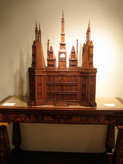 This piece made me think about the late, great Bill Blass; he had a collection of interesting, unique wooden pieces in his apartment. It's a wooden model of what looks like a church. One piece like this is all you need in a room.
