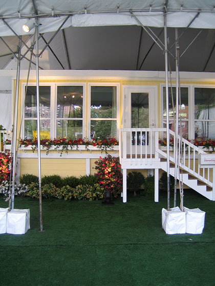 Here's what the trailer looked like from the outside; the exterior of a house, complete with a little <i>faux</i> Astroturf garden. The idea is that HomeGoods can drive this around the country showing some of the new, very well-priced pieces.