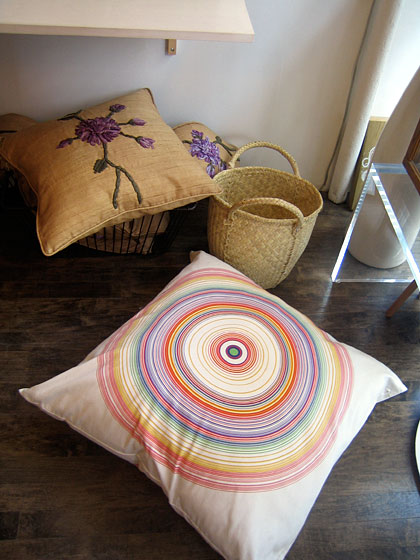 Even her throw pillows are different: Here's what I call her rainbow bull's eye. She has wonderful scarves, including a very lightweight cashmere that you'd even wear in the summer, when the air conditioning is too much.