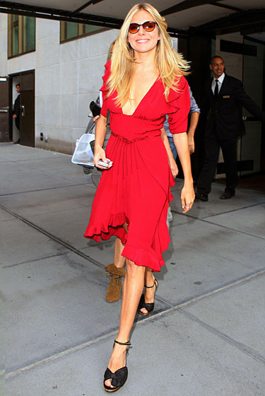Va-va-voom! This, we covet. Sure, Sienna's dress is arguably displaying too much sternum. But slightly questionable fit aside, this flirty red number is attention-grabbing without being obnoxious — presumably what Sienna herself is trying to be.