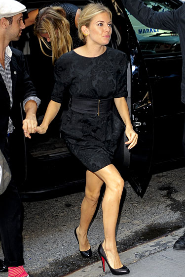 Here, Sienna departed from brighter stuff in favor of a black-on-black look. It's very genteel, but frankly, for a girl ringing the opening bell at the New York Stock Exchange, wearing black as if you are attending the funeral of your bank account is a tad on-the-nose these days.
