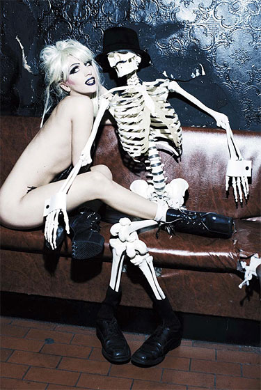 Sleeps with the skeletons, wearing no dresses.