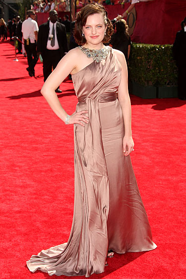 Elizabeth Moss in Reem Acra, with jewelry by Chopard.