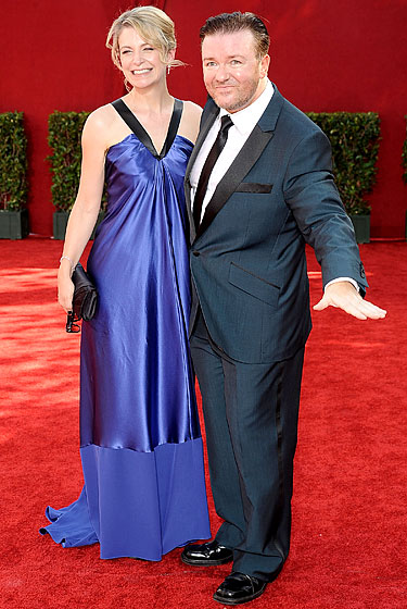 Ricky Gervais in a Ted Baker suit with Jane Fallon.