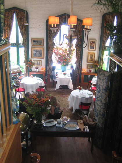 "That intimate table looks down on this lovely view of the private dining room. The menu is called ""Ardois,"" which means ""slate"" in French; Charles writes the daily specials there each day in chalk beside the dish."