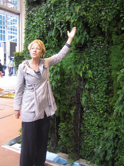 Here's Margie, pointing out different plants. She actually hired her mother, Dorothy Ruddick, who is a great sculptor, to create the abstract figures the plants are covering. All of the planting was grown in Montreal by the fabricator and planter Yves Vaillancourt of Mosaiculture Internationale de Montreal.