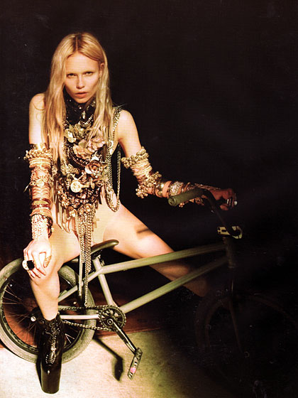 Givenchy designer Riccardo Tisci styled this spread. The only concern is her chains getting stuck in her bike gears, but other than that she's ready for a party at the New Museum.