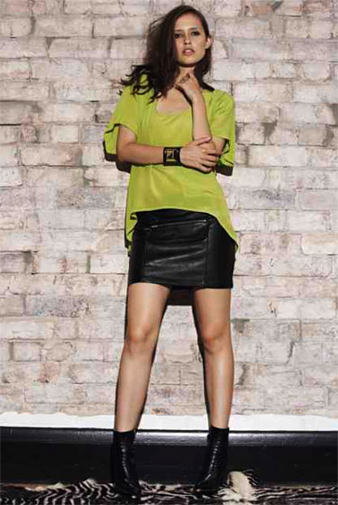 High-front lime silk tee, $169.40; black leather miniskirt, $121.