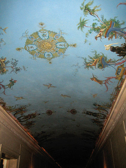The chinoiserie painted canvas on the hallway ceiling was done by J. Alden. Twachtman, and is still beautifully intact.