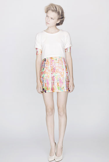 Printed T-shirt dress, $450; soft jersey cropped T-shirt with padding detail, $200.