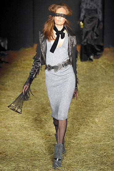 "<a href=""http://nymag.com/fashion/fashionshows/2010/fall/main/newyork/womenrunway/betseyjohnson/ "">Betsey Johnson</a> showed a Western-inspired jacket."