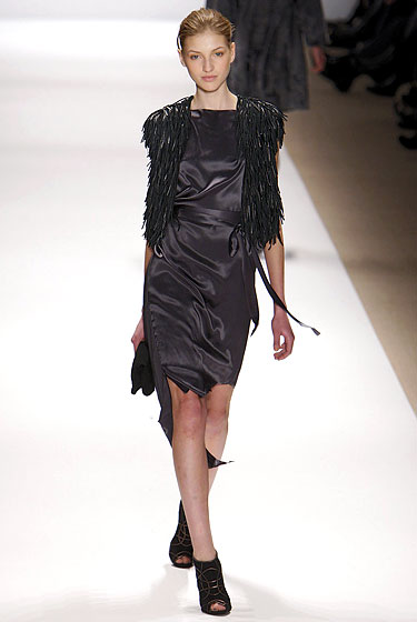 "<a href=""http://nymag.com/fashion/fashionshows/2010/fall/main/newyork/womenrunway/carlosmiele/ "">Carlos Miele</a>'s shredded vest added proportion to a black dress."