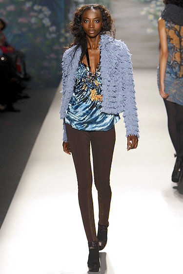 "<a href=""http://nymag.com/fashion/fashionshows/2010/fall/main/newyork/womenrunway/tracyreese/ "">Tracy Reese</a> mixed color with fringe with this light-blue jacket."