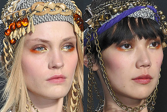 "<a href=""http://nymag.com/fashion/fashionshows/2010/fall/main/newyork/womenrunway/alexandreherchcovitch/"">Alexandre Herchcovitch</a>'s eyes were painted in saturated yellow-gold and orange colors."
