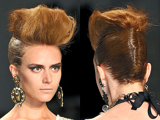 "At <a href=""http://nymag.com/fashion/fashionshows/2010/fall/main/newyork/womenrunway/naeemkhan/"">Naeem Khan</a>, Bumble and bumble.'s Laurent Philippon went for a ""rock-and-roll glamour"" look by teasing the front into a bouffant and winding the back into a French twist."