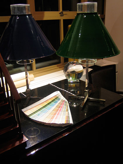 The base of these little table lamps is nickel, and you can order the shades in all those colors you see on the table. For more information on these, call 843-723-8140.
