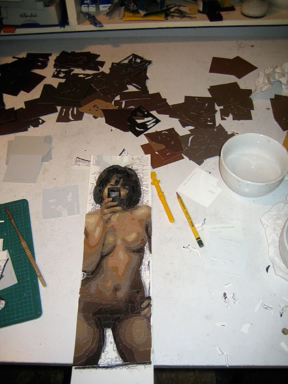 Sturgill's medium is Ralph Lauren paint chips — the small paper swatches you can find at Home Depot. He meticulously cuts and layers them to make his works of art. Here's a nude crafted from tiny pieces of paint chips.