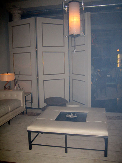 This is another portion of the (smoky) showroom, with more of Bill's designs, including that giant white ottoman.