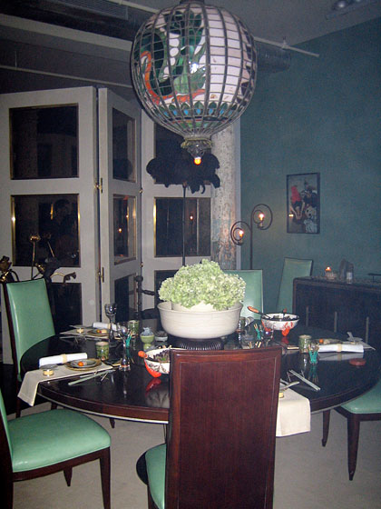 Here's another Sofield dramatic table setting, with his designs.