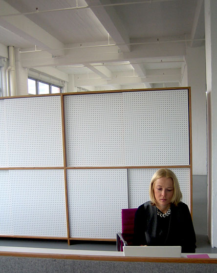These are pegboard shelving units — I love the clean look. Again, very utilitarian materials for a very clean look.